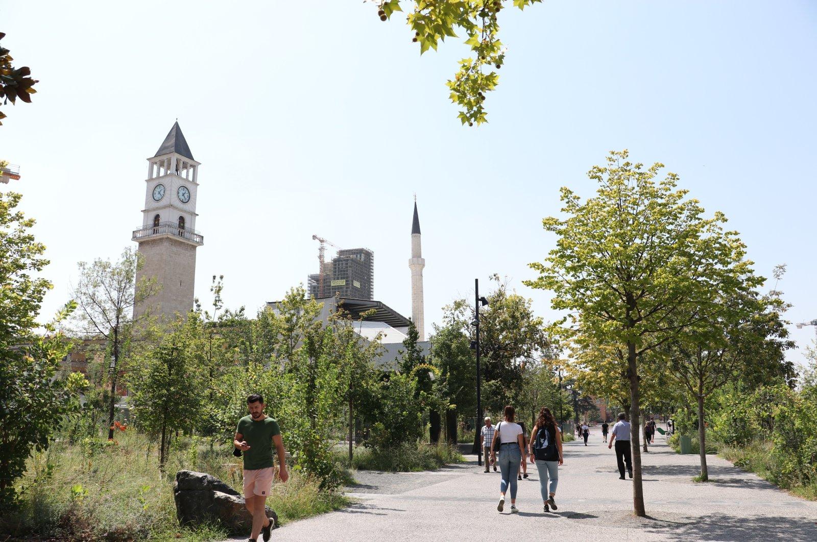 Some passersby are seen near the Clock Tower, Tirana, Albania, Aug. 22, 2020. (AA PHOTO)