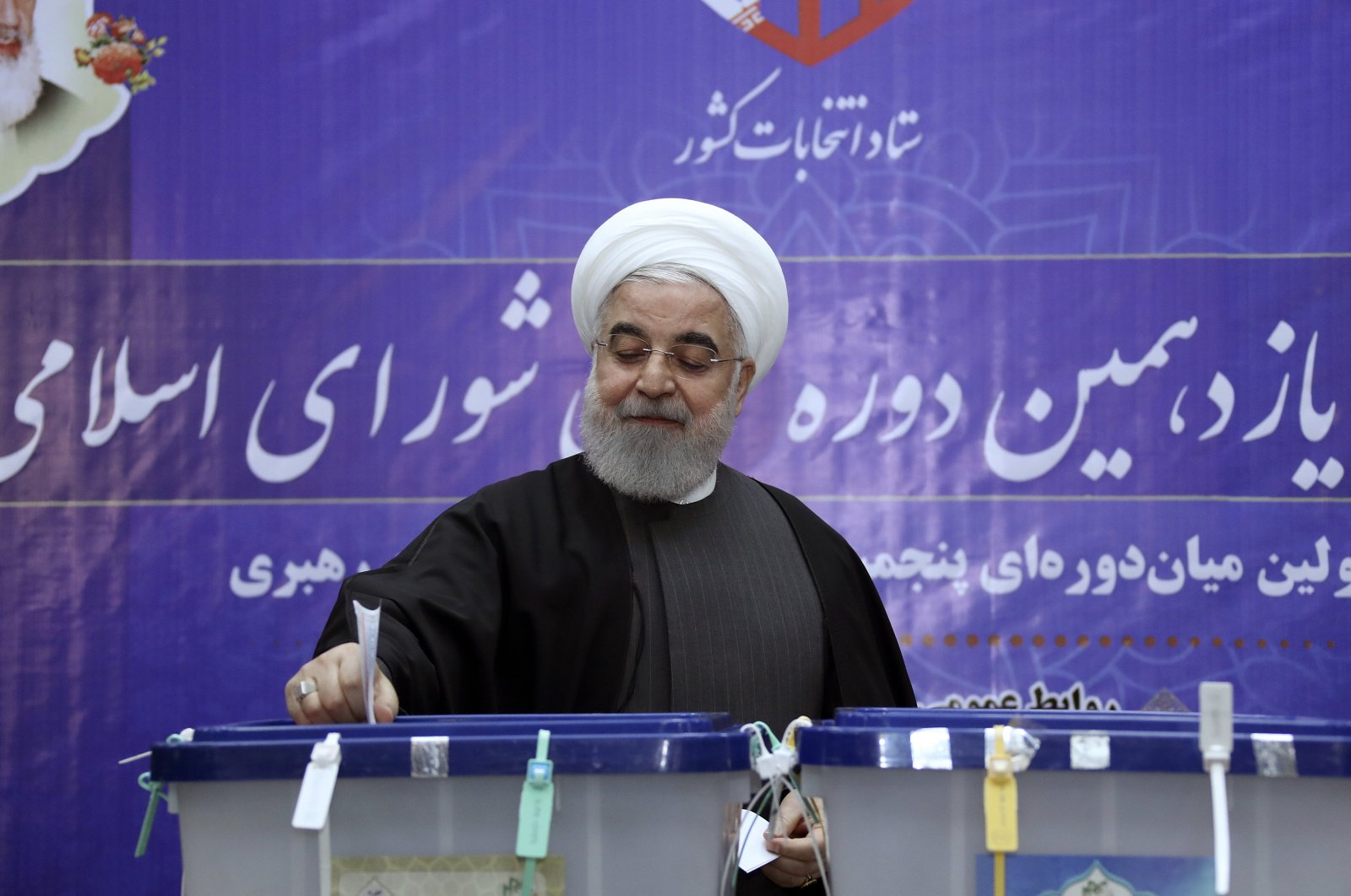 In this photo released by the official website of the office of the Iranian presidency, President Hassan Rouhani casts his ballot in the parliamentary elections at the interior ministry in Tehran, Iran, Feb. 21, 2020. (Iranian Presidency Office Photo via AP)