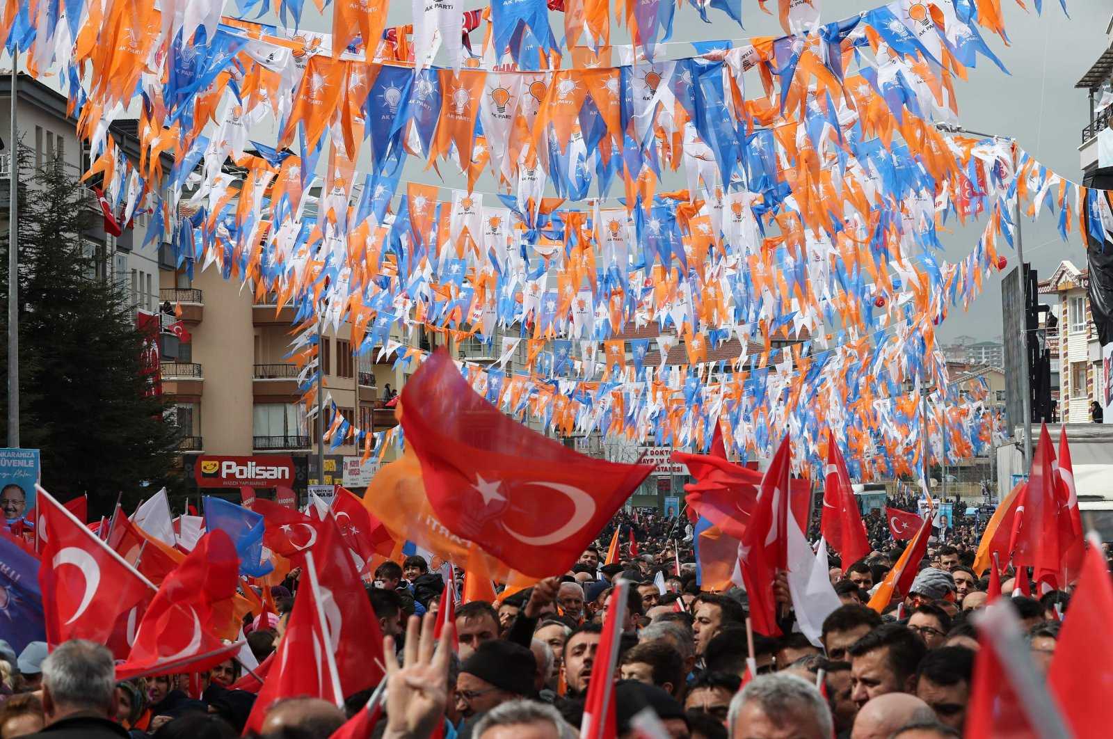 People wave flags as they gather to listen to President Recep Tayyip Erdoğan, the ruling Justice and Development Party's (AK Party) leader, during a party campaign rally in Ankara, Turkey, March 13, 2019. (AFP Photo)