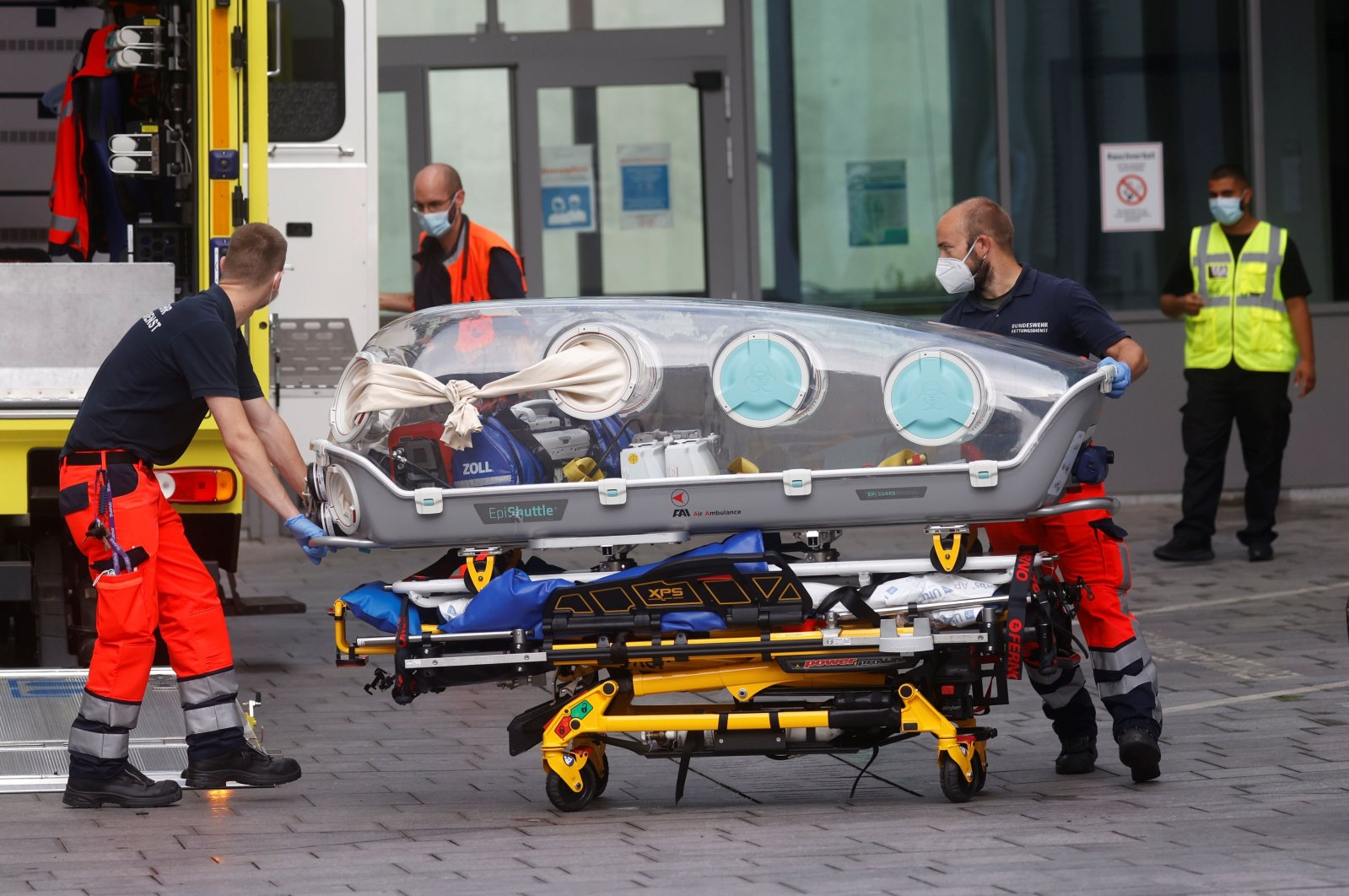German army emergency personnel load into their ambulance the stretcher that was used to transport Russian opposition figure Alexei Navalny at Berlin's Charite hospital, where Navalny is being following a suspected poisoning, Germany, Aug. 22, 2020. (AFP Photo)