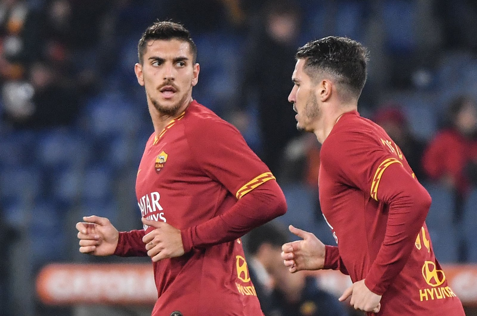 AS Roma's Turkish defender Mert Çetin (R) celebrates a goal with Italian midfielder Lorenzo Pellegrini during the Italian Serie A football match between AS Roma and Spal at the Olympic Stadium in Rome, Italy, Dec. 15, 2019. (AFP Photo)