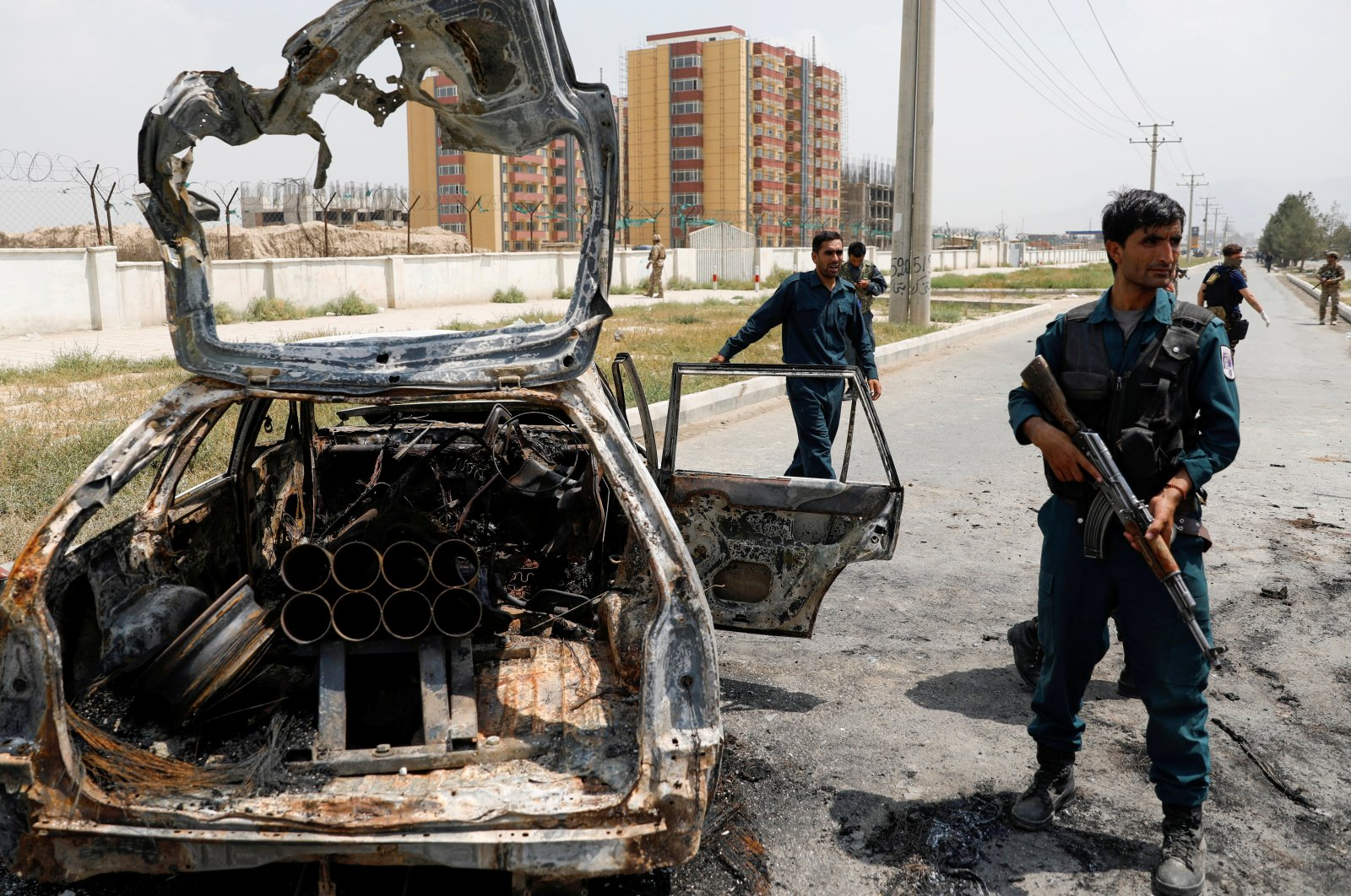 Afghan police officers inspect a vehicle from which insurgents fired rockets, in Kabul, Afghanistan, Aug. 18, 2020. Reuters Photo)