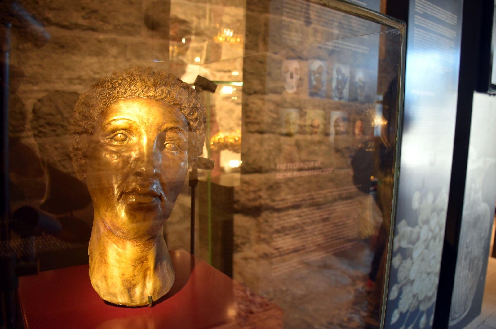 "The original face mask of the ""Carian Princess"" made to adorn the skeleton."