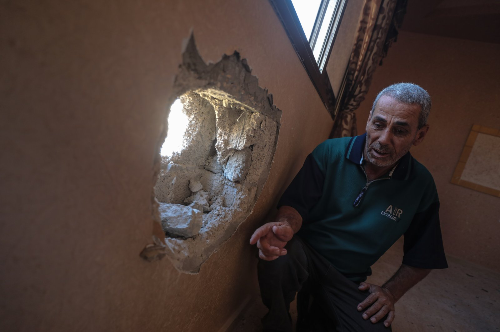 A Palestinian home is damaged during Israeli airstrikes, Khan Younis, Gaza Strip, Aug. 24, 2020. (AA Photo)