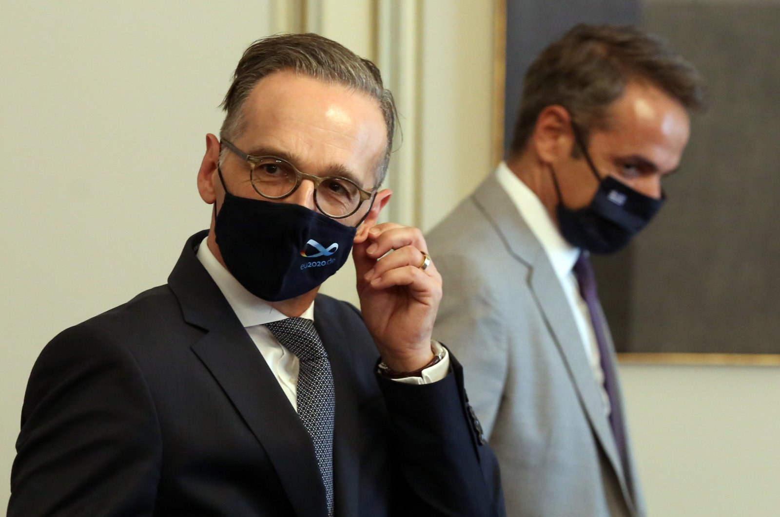 Foreign Minister of Germany Heiko Maas (L) takes off his mask during his meeting with Greek Prime Minister Kyriakos Mitsotakis (R), in Athens, Greece, Aug. 25, 2020. (EPA Photo)