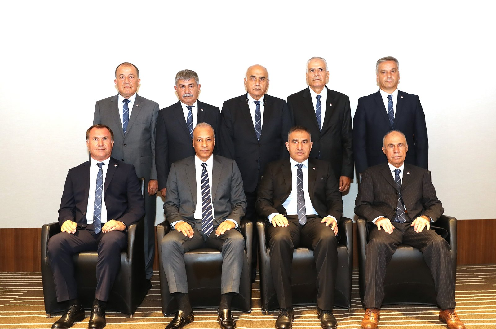 Serdar Tatlı (front 2nd left) poses with his fellow committee members in TFF headquarters in Istanbul, Turkey, Aug. 25, 2020. (IHA Photo)