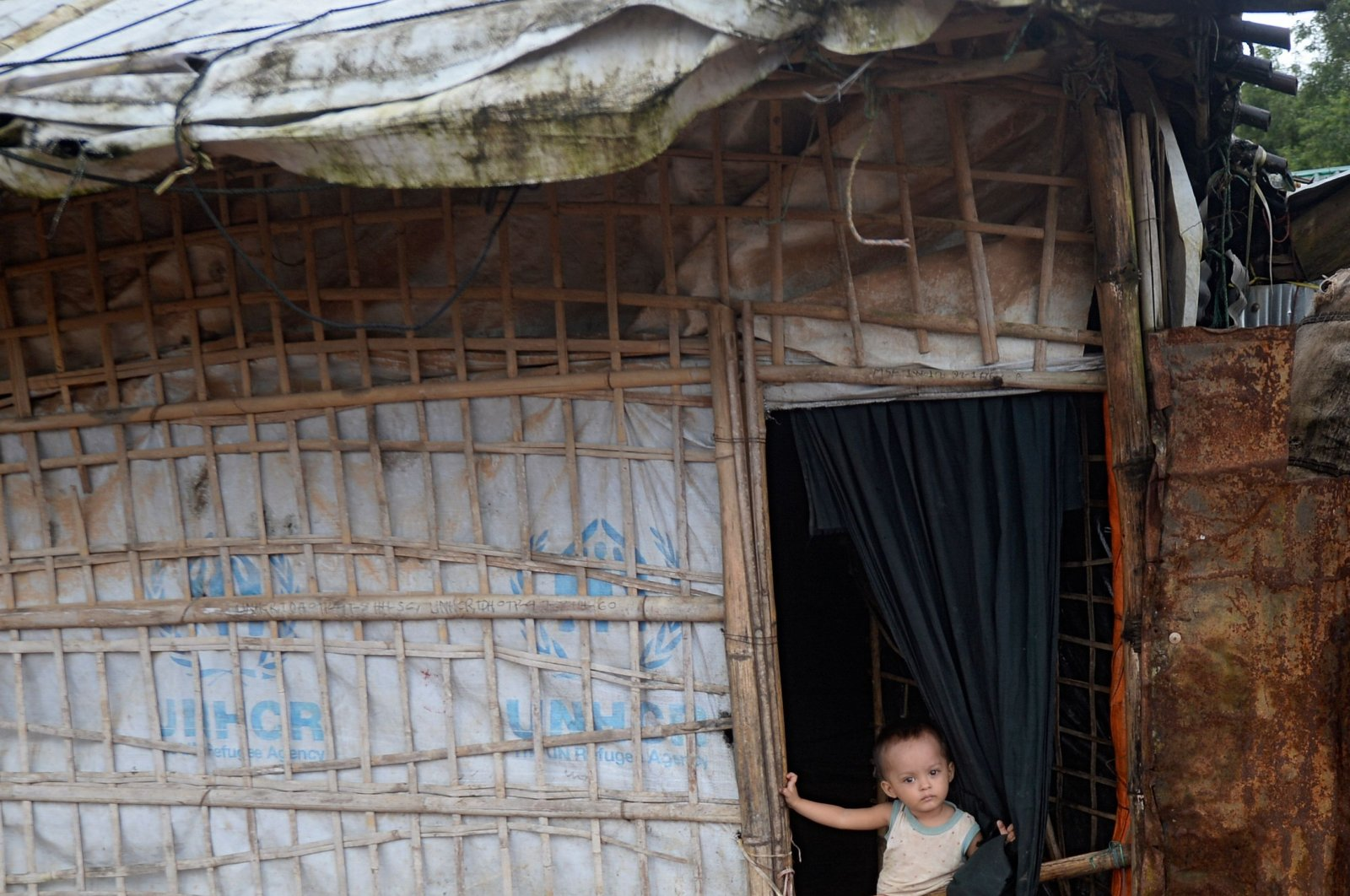 A child stands at the entrance of a house at Kutupalong refugee camp near Ukhia, Chittagong, Bangladesh, Aug. 25, 2020. (AFP Photo)