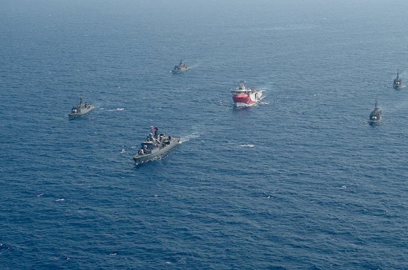 Turkey's research vessel, Oruç Reis, center, is surrounded by Turkish navy vessels as it was heading in the west of Antalya on the eastern Mediterranean, Aug. 10, 2020. (AP Photo)