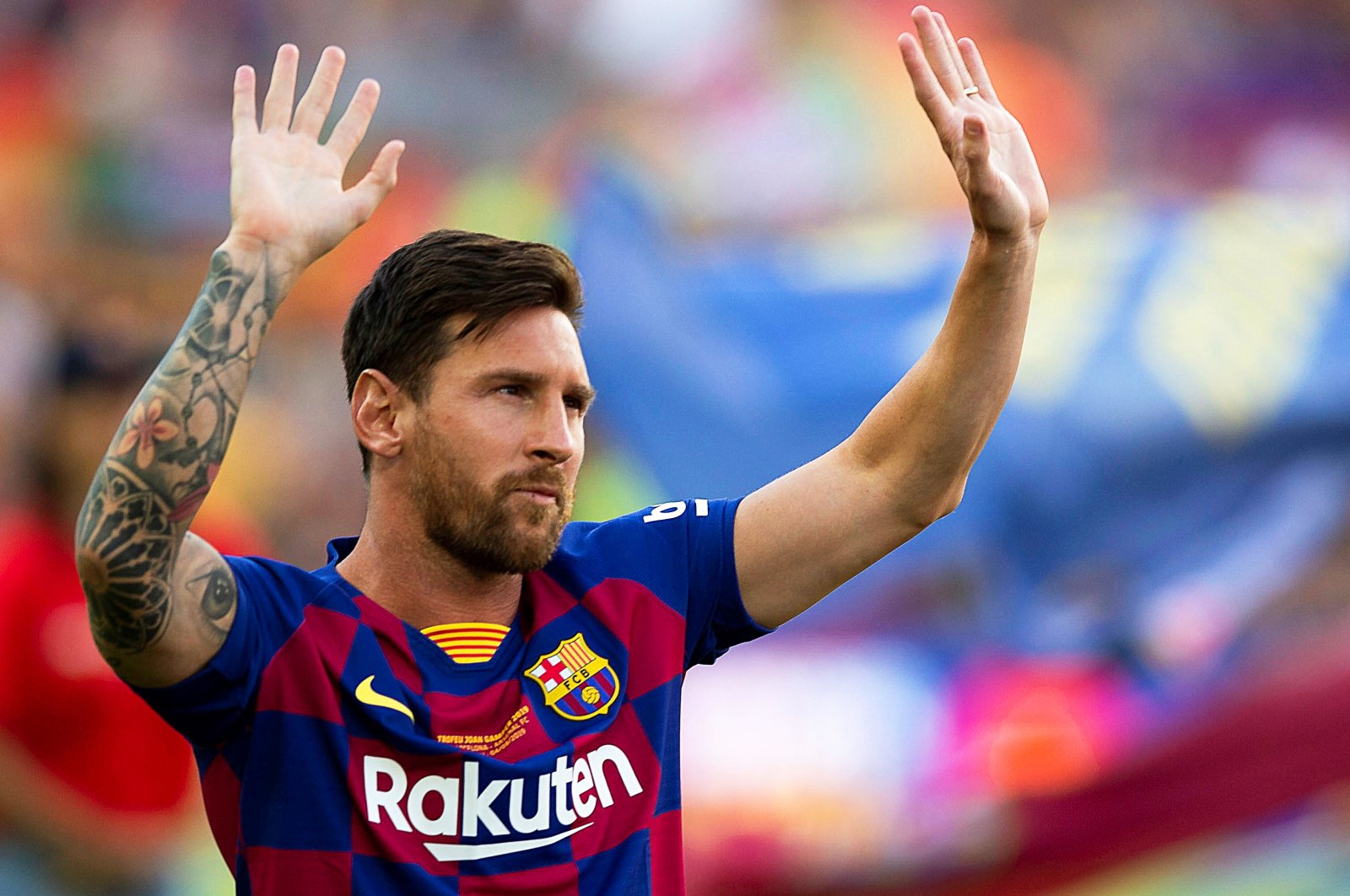 Barcelona's Lionel Messi greets fans prior to a friendly match against Arsenal in Barcelona, Spain, Aug. 4, 2019. (EPA Photo)