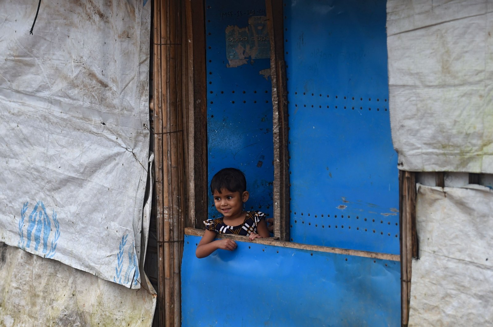 A child stands at the entrance of a house in Kutupalong refugee camp near Ukhia, Bangladesh, Aug. 25, 2020. (AFP Photo)