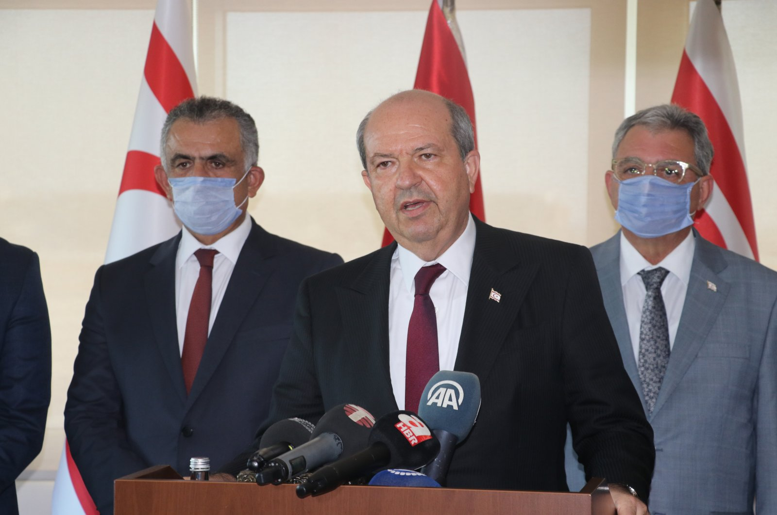 TRNC PM Ersin Tatar (C) gives a press conference in Nicosia's Ercan International Airport after returning to the island of Cyprus after official talks in Turkey, Aug. 5, 2020 (AA Photo)
