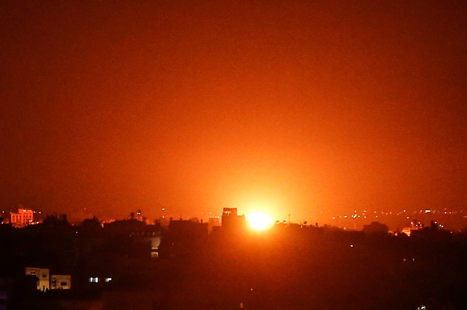 The sky is lit up after war planes belonging to the Israeli army carried out airstrikes over Gaza city, Aug. 21, 2020. (AFP Photo)