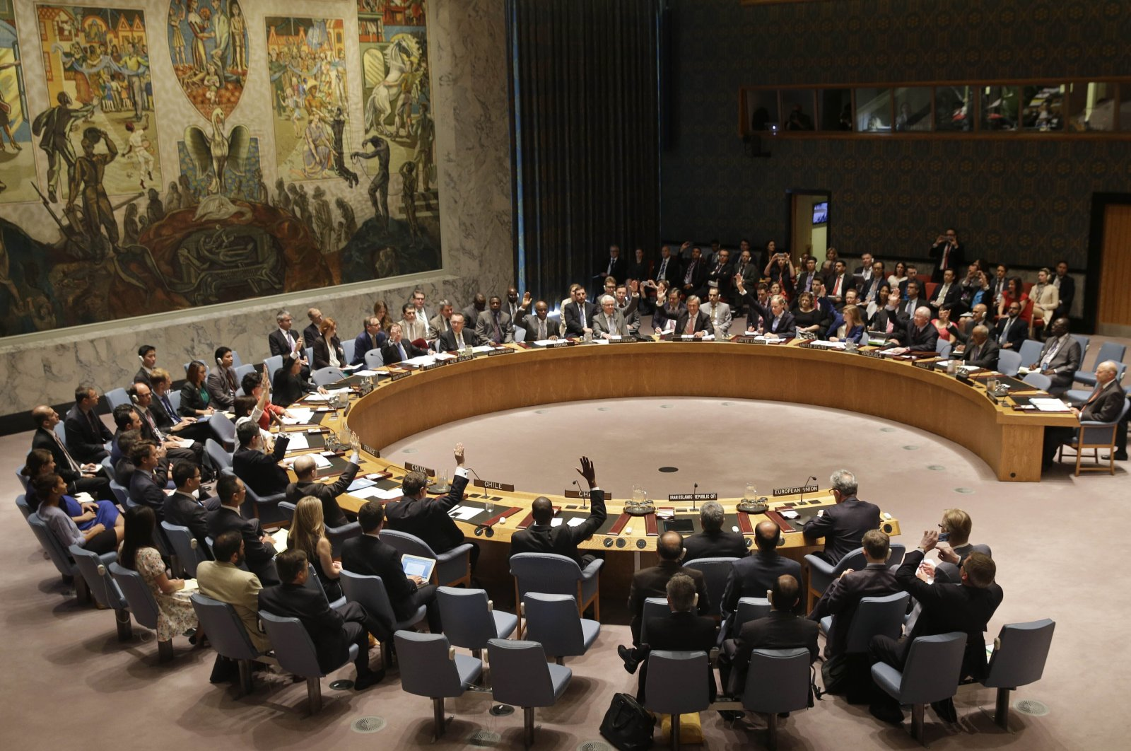 Members of the Security Council vote at United Nations headquarters on the landmark nuclear deal between Iran and six world powers, New York City, New York, U.S., July 20, 2015. (AP Photo)