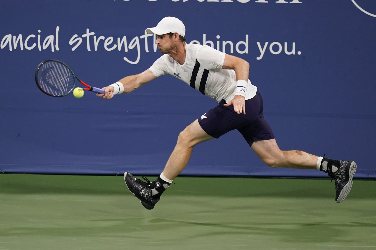 Andy Murray stretches for a ball from Milos Raonic during the third round at the Western & Southern Open tennis tournament in New York, U.S., Aug. 25, 2020. (AP Photo)