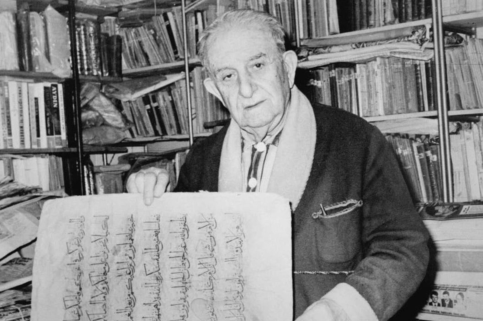 In this undated file photo, Ibrahim Hakkı Konyalı is seen with a document in a library.