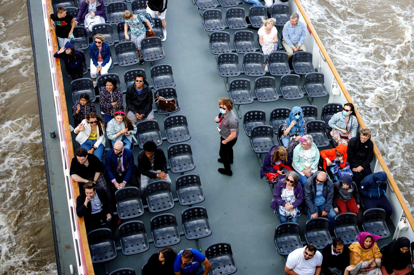 People enjoy a cruise tour on River Thames in central London, U.K., Aug. 24, 2020. (AFP Photo)