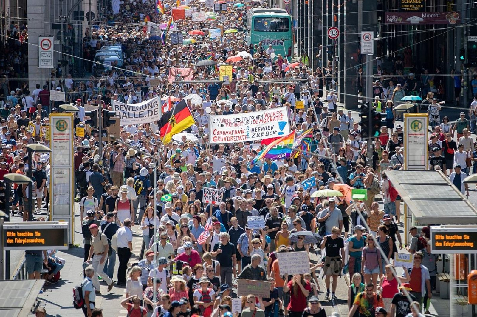 """Thousands march along the """"Friedrichstrasse"""" during a demonstration against coronavirus curbs in Berlin, Germany, Aug. 2, 2020. (AP Photo)"""
