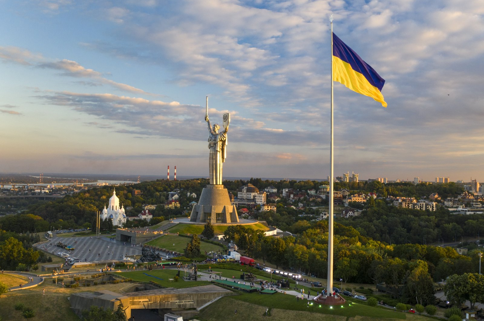 Ukraine's biggest flag flies 90 meters above Kyiv after it was installed on the eve of the State Flag Day, with the Motherland Monument at the center, Ukraine, Aug. 22, 2020. (AP Photo)