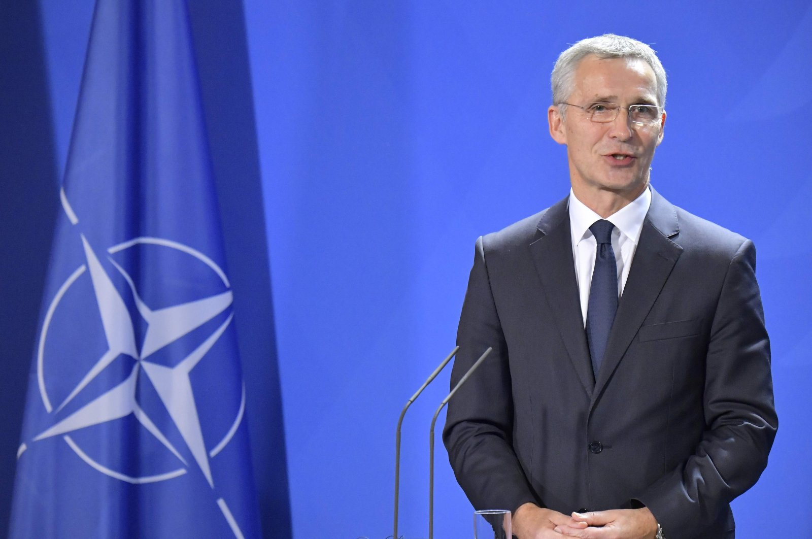 NATO Secretary-General Jens Stoltenberg addresses a joint news conference with German Chancellor Angela Merkel in Berlin, Germany, Nov. 7, 2019.  (AFP Photo)