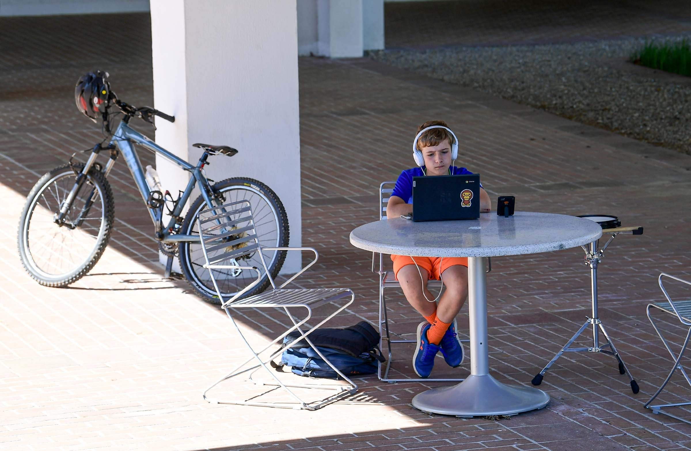 Andrew Connelly of Clemson works on his homework from R.C. Edwards Middle School, sitting outside the Cooper Library at Clemson University, Clemson, South Carolina, U.S. (Reuters Photo)