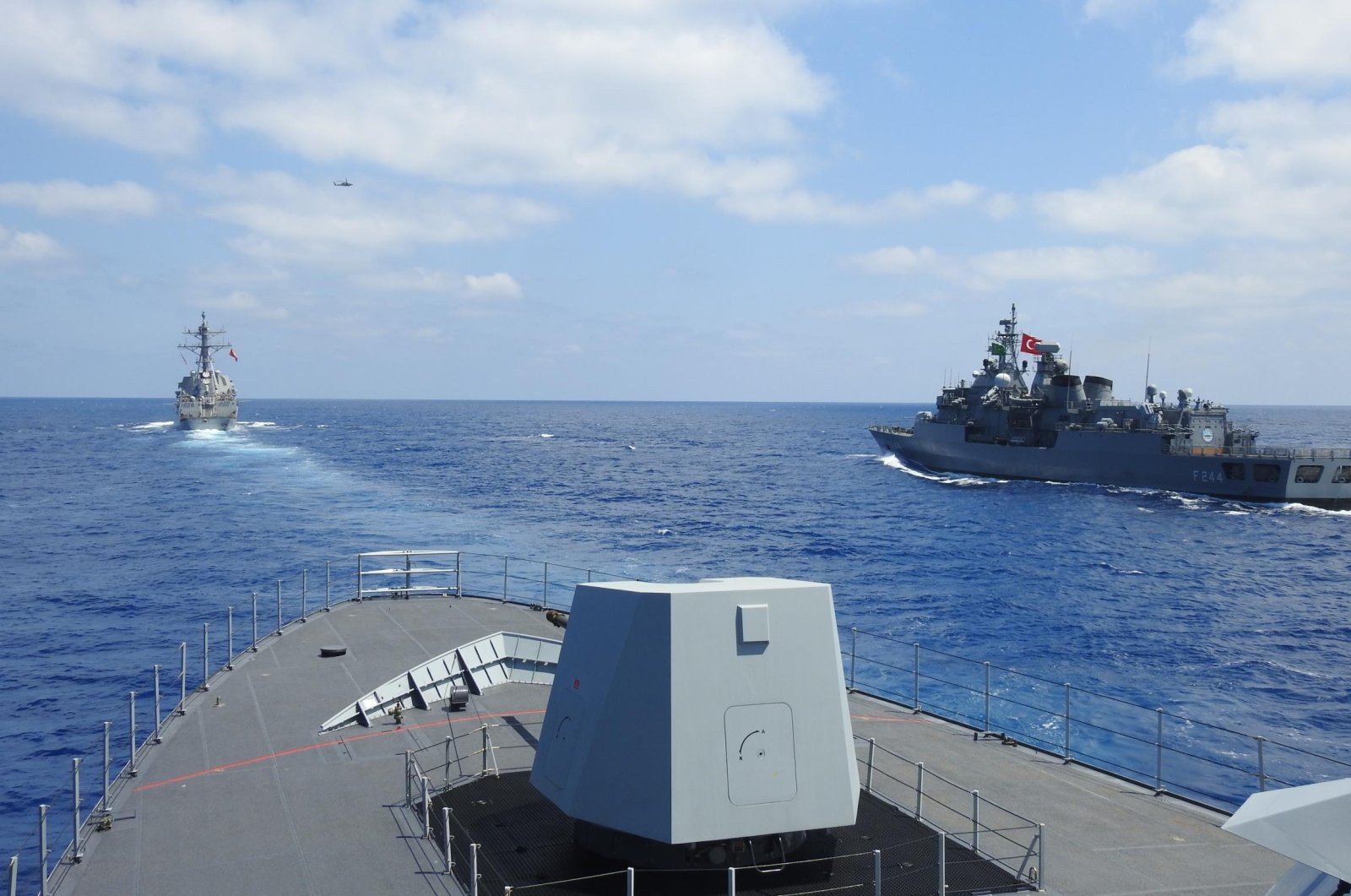 Turkey's TCG Barbaros frigate and TCG Burgazada corvette and the USS Winston S. Churchill conduct naval training exercises in the Eastern Mediterranean on Aug. 26, 2020. (AA Photo)
