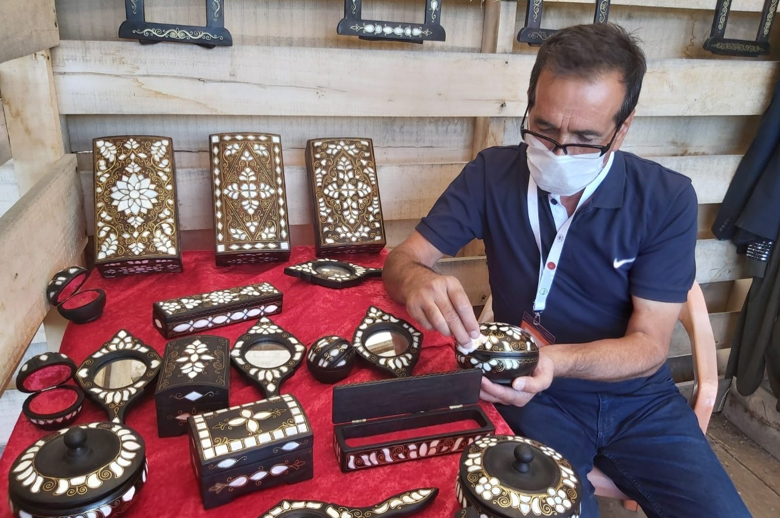 """A mother-of-pearl inlay maker and his works are seen at a workshop opened as part of the """"Turkey on UNESCO's Intangible Cultural Heritage Lists Exhibition,"""" Bitlis, eastern Turkey, Aug. 26, 2020. (AA PHOTO)"""