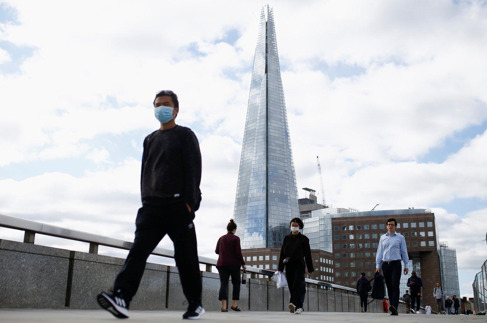 People walk over the London Bridge amid the coronavirus outbreak, London, Britain, Aug. 26, 2020. (Reuters Photo)