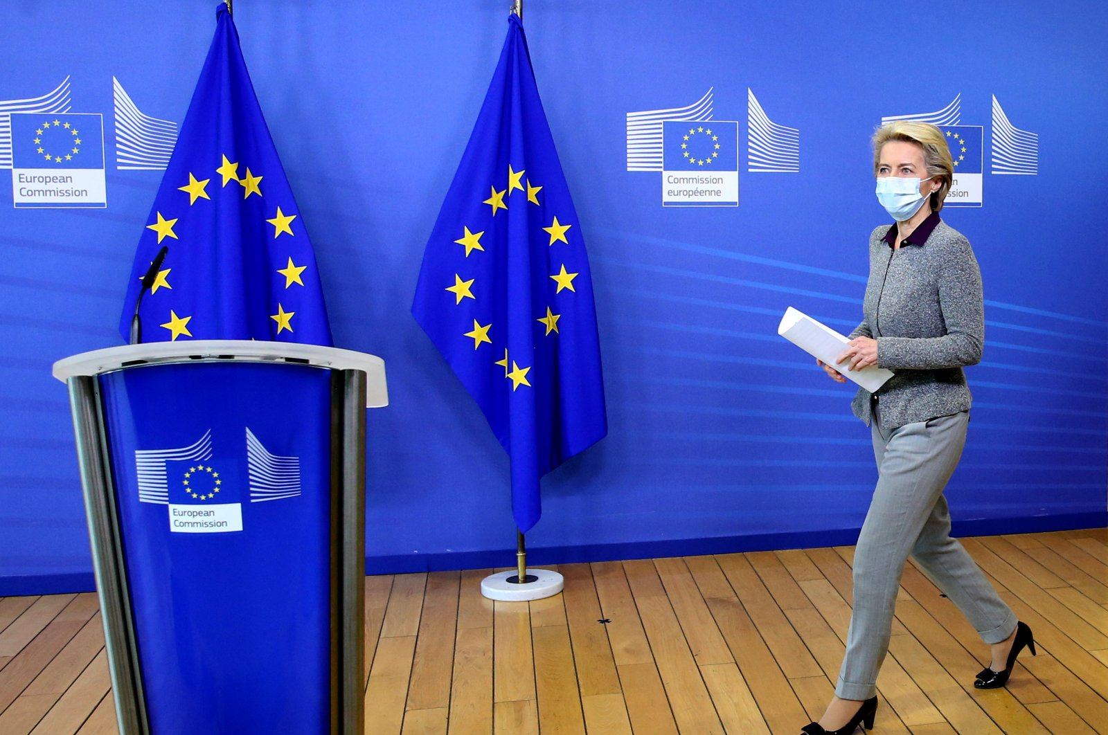 President of the European Commission Ursula von der Leyen, wearing a protective face mask, arrives for a media conference at EU headquarters in Brussels, Aug. 27, 2020. (AP Photo)