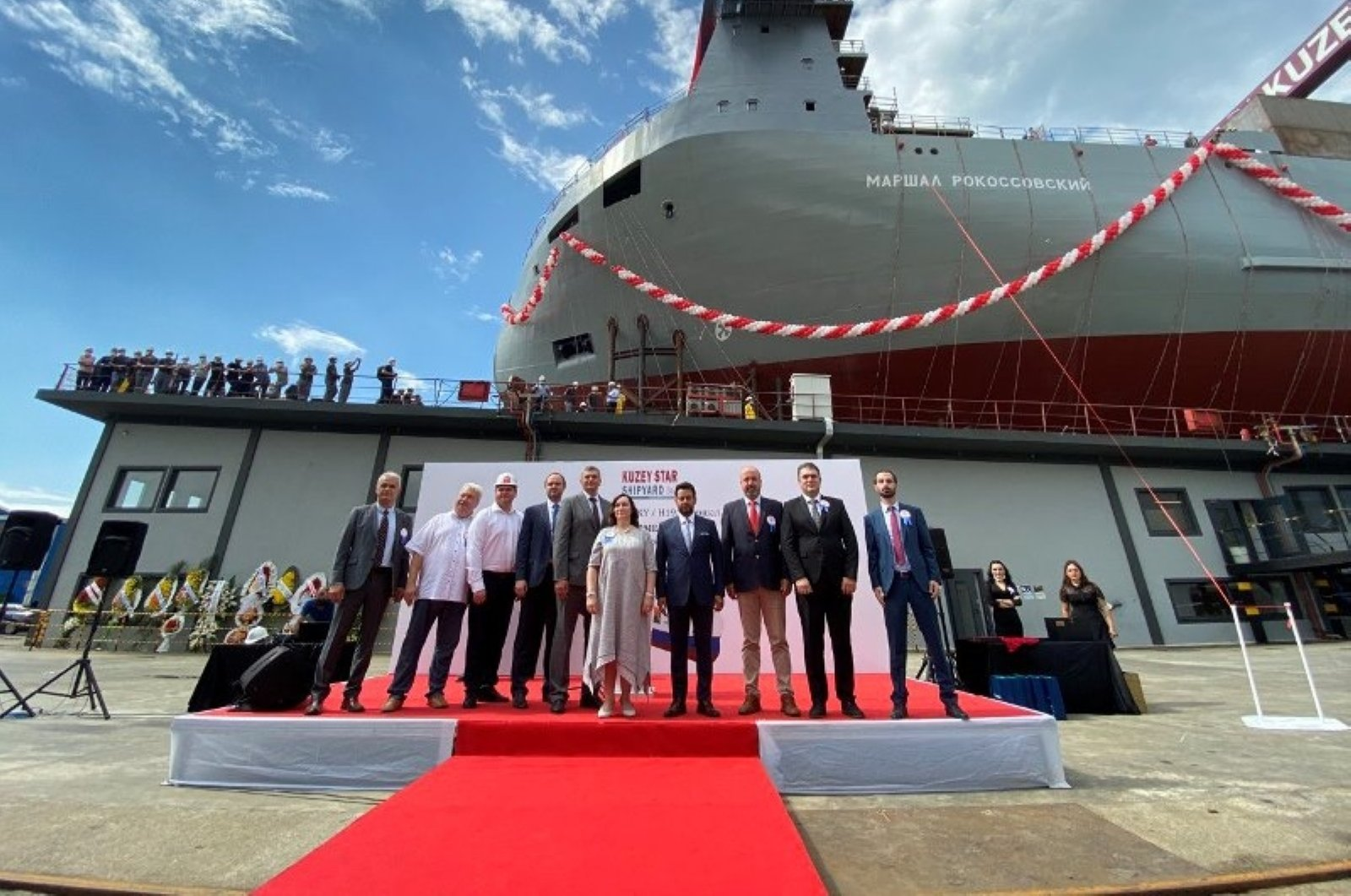 FSUE Rosmorport and Kuzey Star Shipyard officials are seen in front of the Marshal Rokossovsky ferry during its launching ceremony in Tuzla, Istanbul, Turkey, Aug. 21, 2020. (Photo courtesy of FSUE Rosmorport)