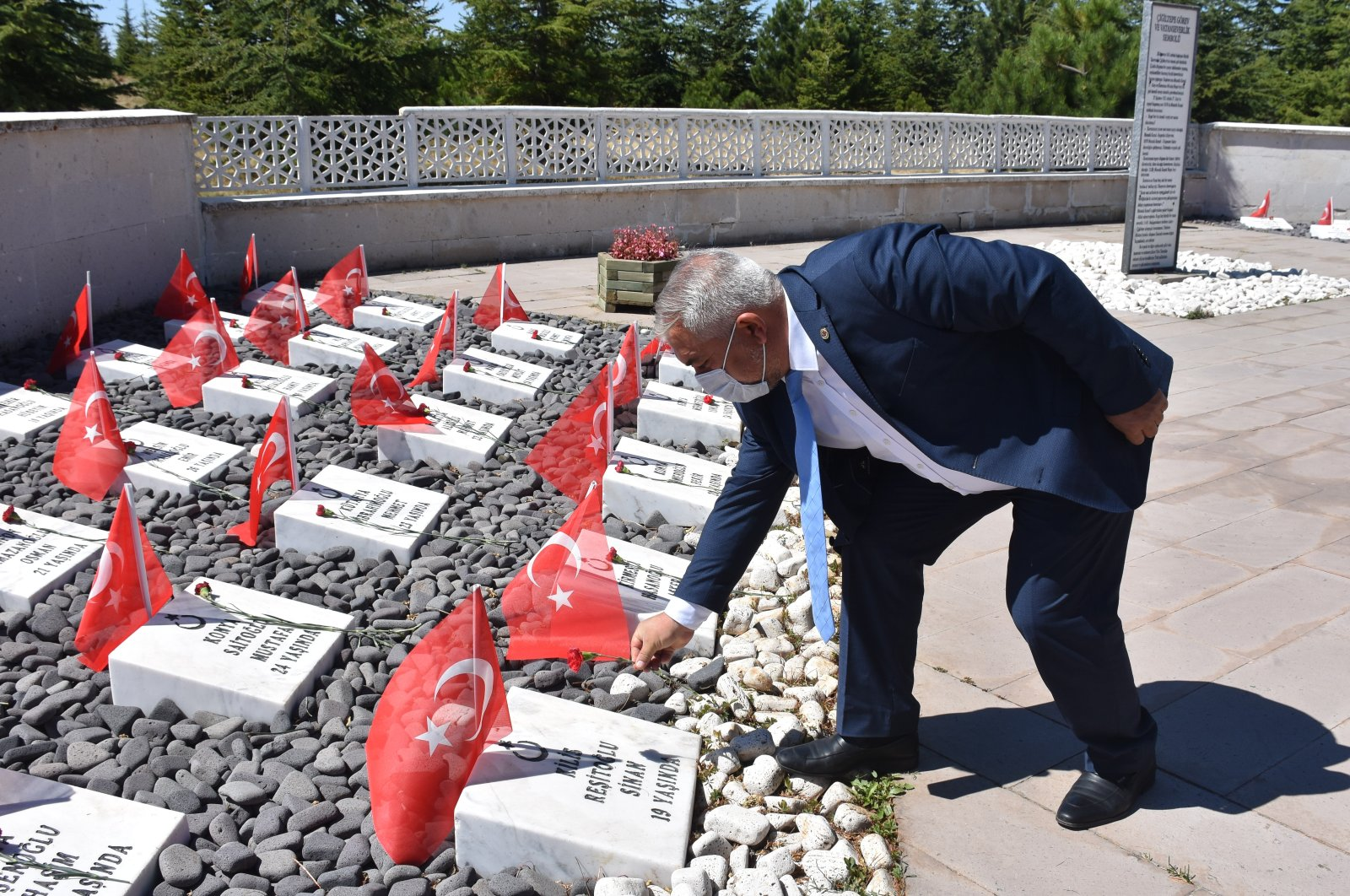 A man leaves flowers at the graves of soldiers slain in the Great Offensive, in Afyonkarahisar, western Turkey, Aug. 27, 2020. (AA Photo)