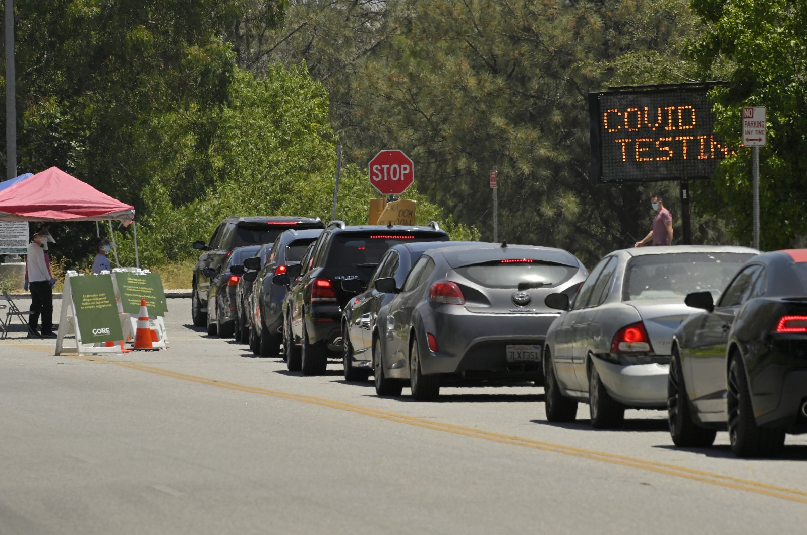 Cars line up for COVID-19 testing at Hansen Dam Recreation Center, Los Angeles. C.A., July 7, 2020. (AP Photo)
