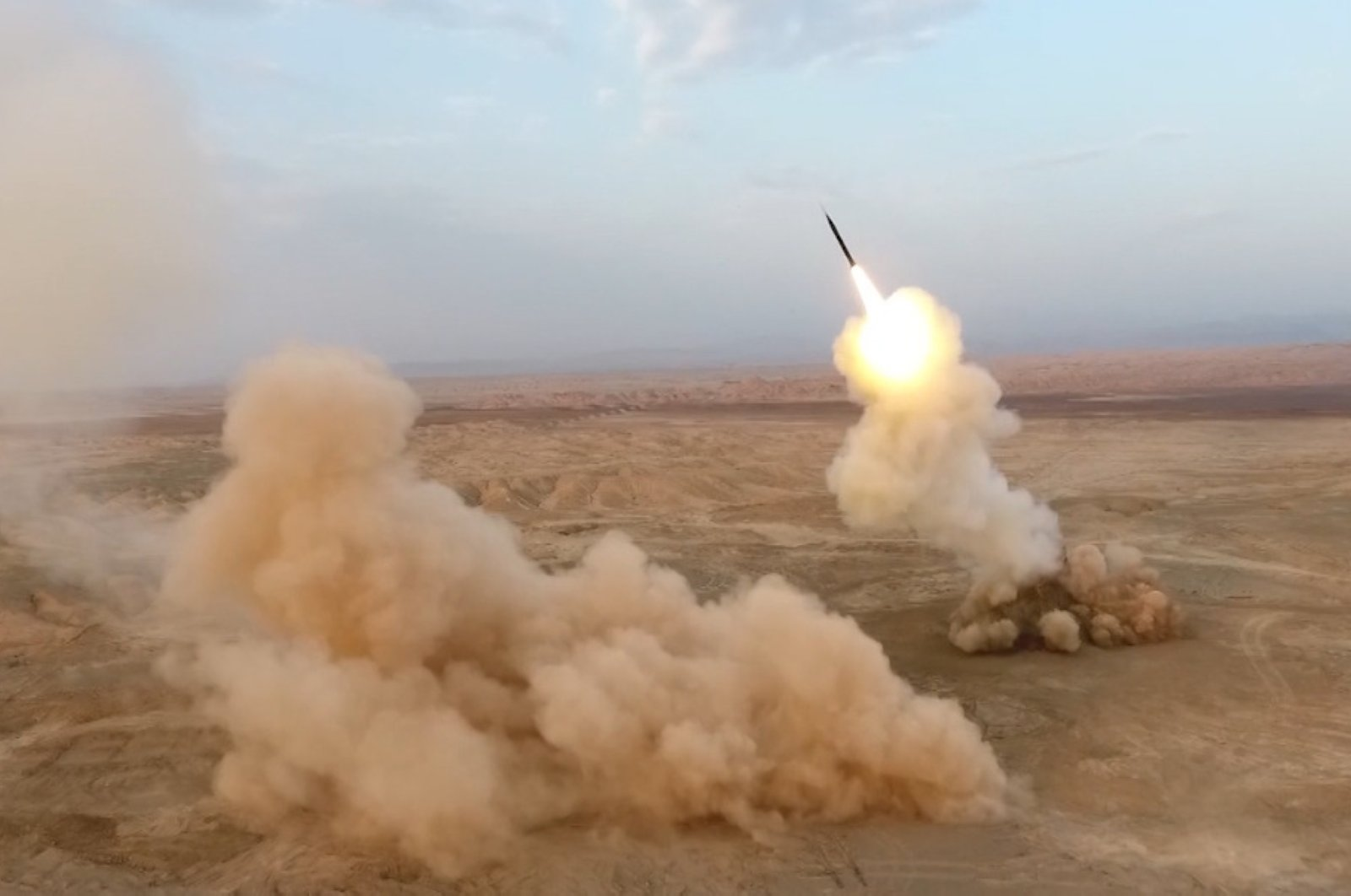 This file photo provided by Iran's Revolutionary Guard Corps (IRGC) official website via SEPAH News on July 28, 2020, shows ballistic missiles being launched from underground by Iran's Revolutionary Guard Corps (IRGC) during the last day of military exercises near sensitive Gulf waters. (AFP PHOTO / IRGC via SEPAH NEWS)
