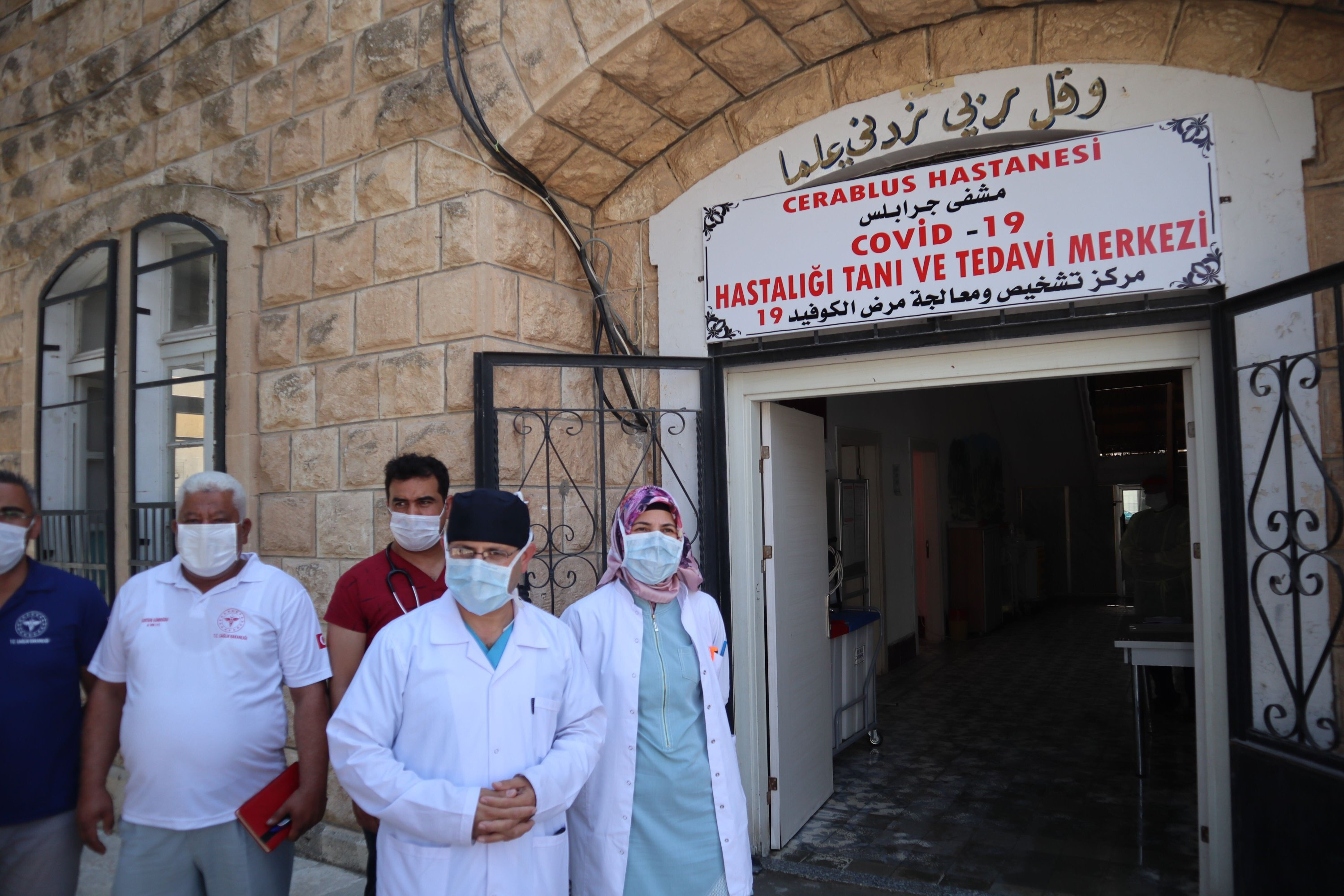 Chief physician Yasin Şahin stands in front of health staff at the COVID-19 hospital in Jarablus, Syria, Aug. 27, 2020 (Dilara Aslan)
