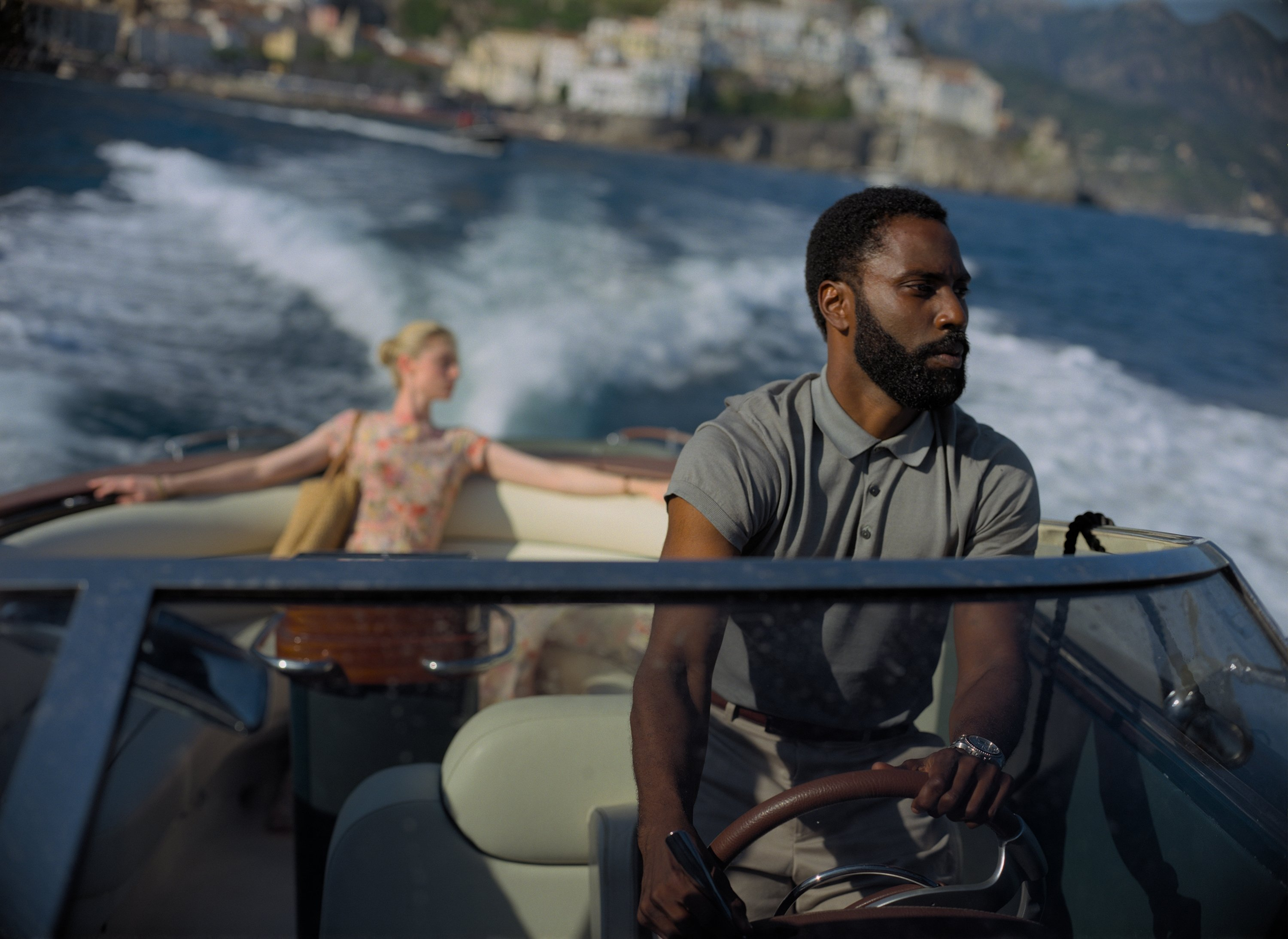 John David Washington as The Protagonist and Elizabeth Debicki as Kat in the background. (AP PHOTO)