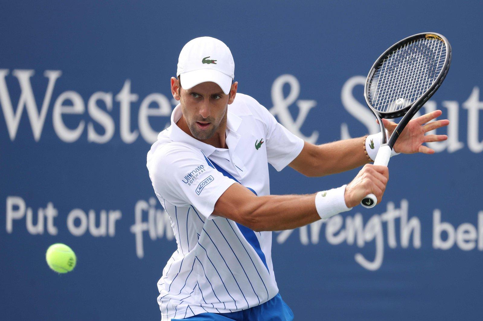 Novak Djokovic  returns a shot against Jan Leonard Struff during the Western & Southern Open, New York City, New York, U.S., Aug. 26, 2020. (AFP Photo)