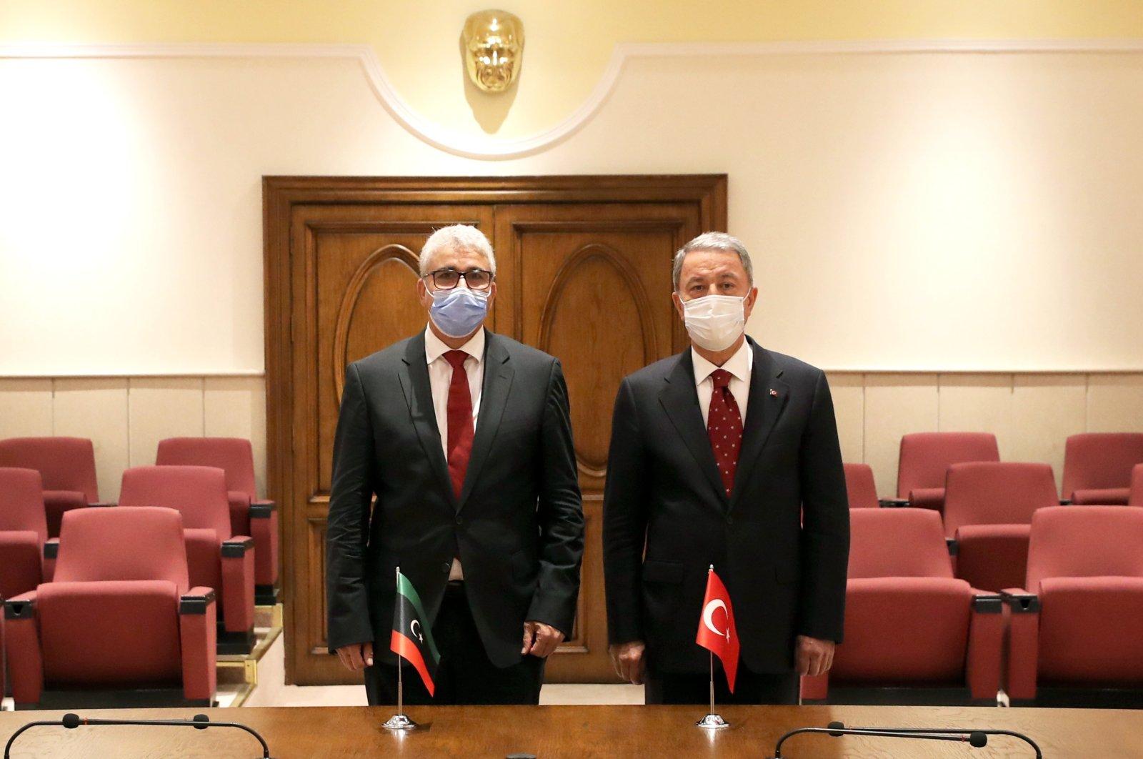 Defense Minister Hulusi Akar (R) receives Libya's Interior Minister Fathi Bashagha in the capital Ankara, Turkey, Aug. 28, 2020. (AA Photo)