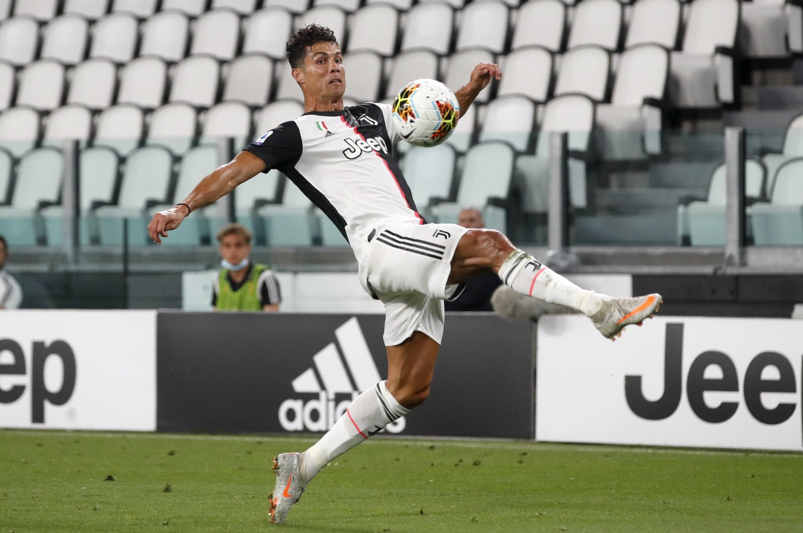 Cristiano Ronaldo tries to control the ball in a match against Sampdoria, in Turin, Italy, July 26, 2020. (AP Photo)