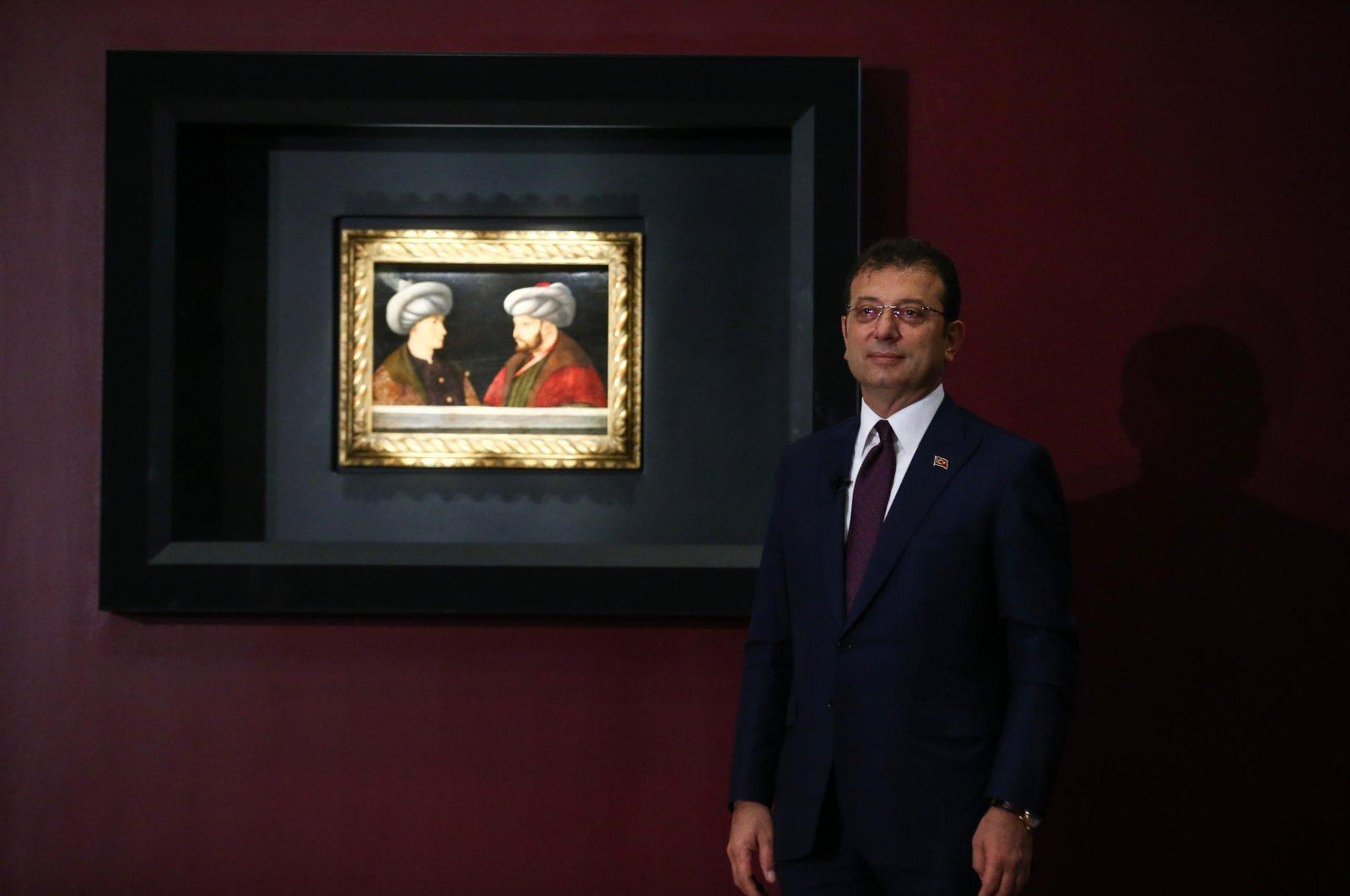 Mayor Ekrem Imamoğlu poses next to the portrait, in Istanbul, Turkey, Aug. 28, 2020. (AA Photo)