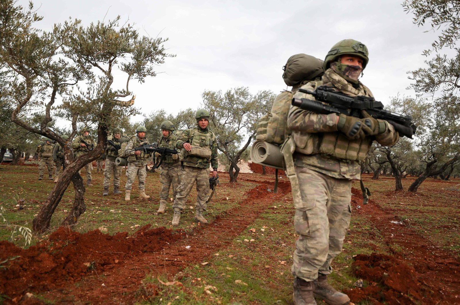 Turkish soldiers gather in the village of Qaminas, about 6 kilometers (3.7 miles) southeast of Idlib city in northwestern Syria, Feb. 10, 2020. (AFP Photo)