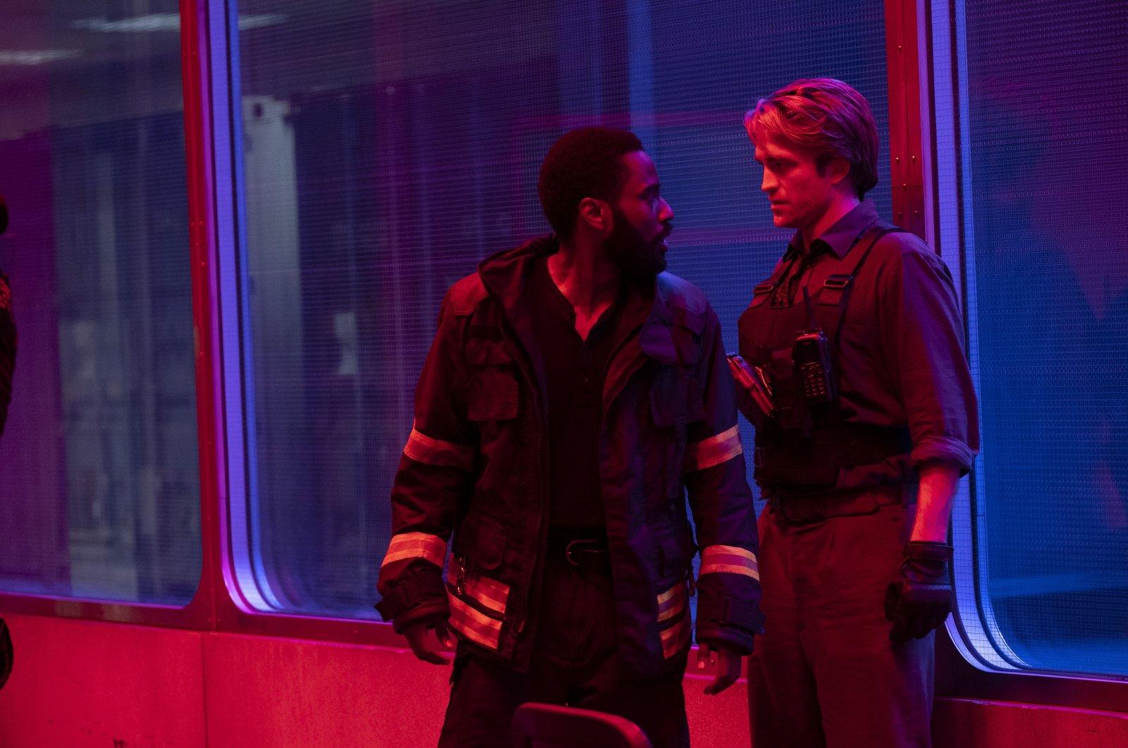 """John David Washington (L) and Robert Pattinson in a scene in """"Tenet."""" (AP PHOTO)"""