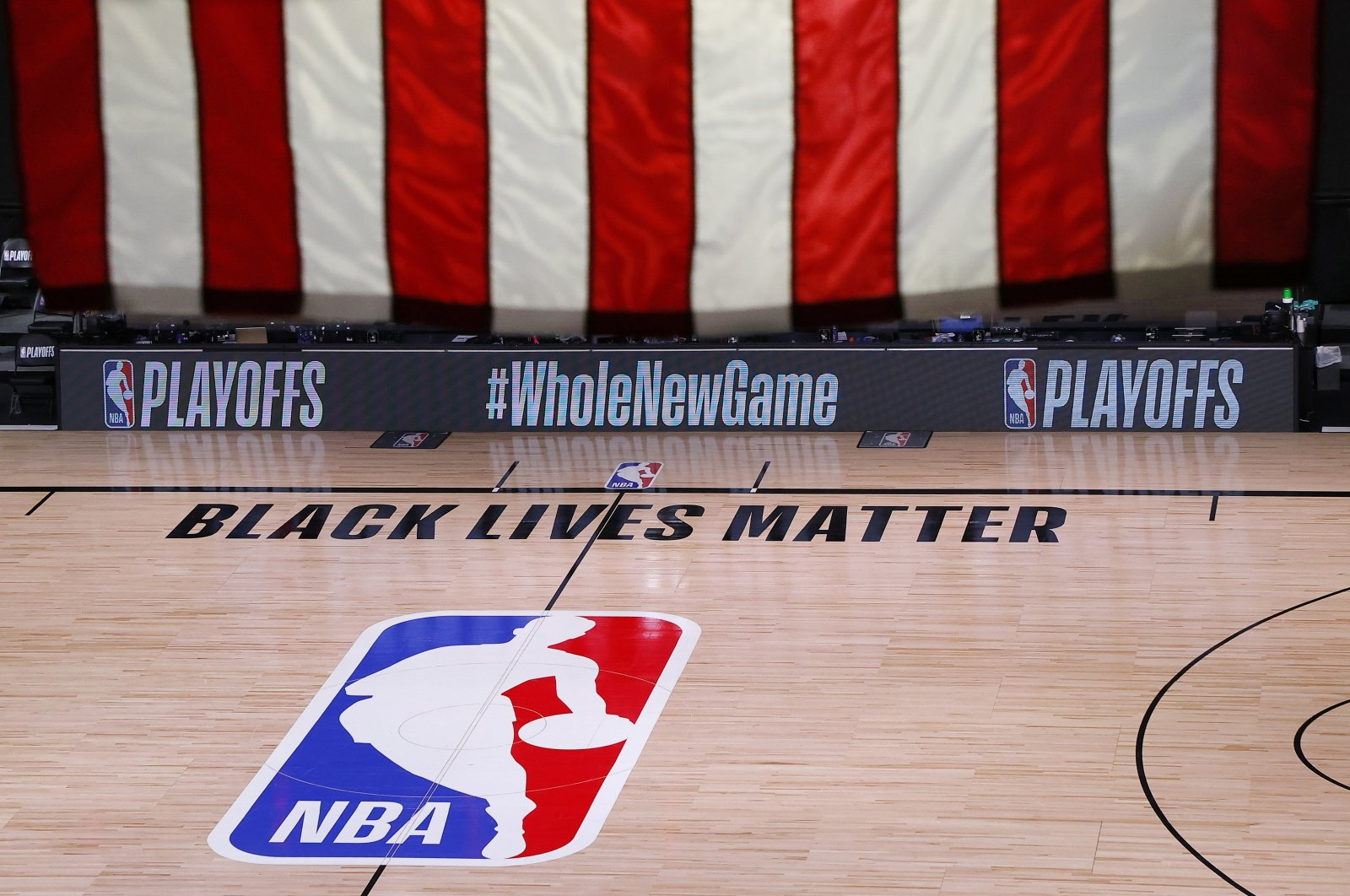 An empty court and bench are shown following the scheduled start time of Game 5 of an NBA basketball first-round playoff series, in Lake Buena Vista, Florida on Aug. 26, 2020. (AP Photo)