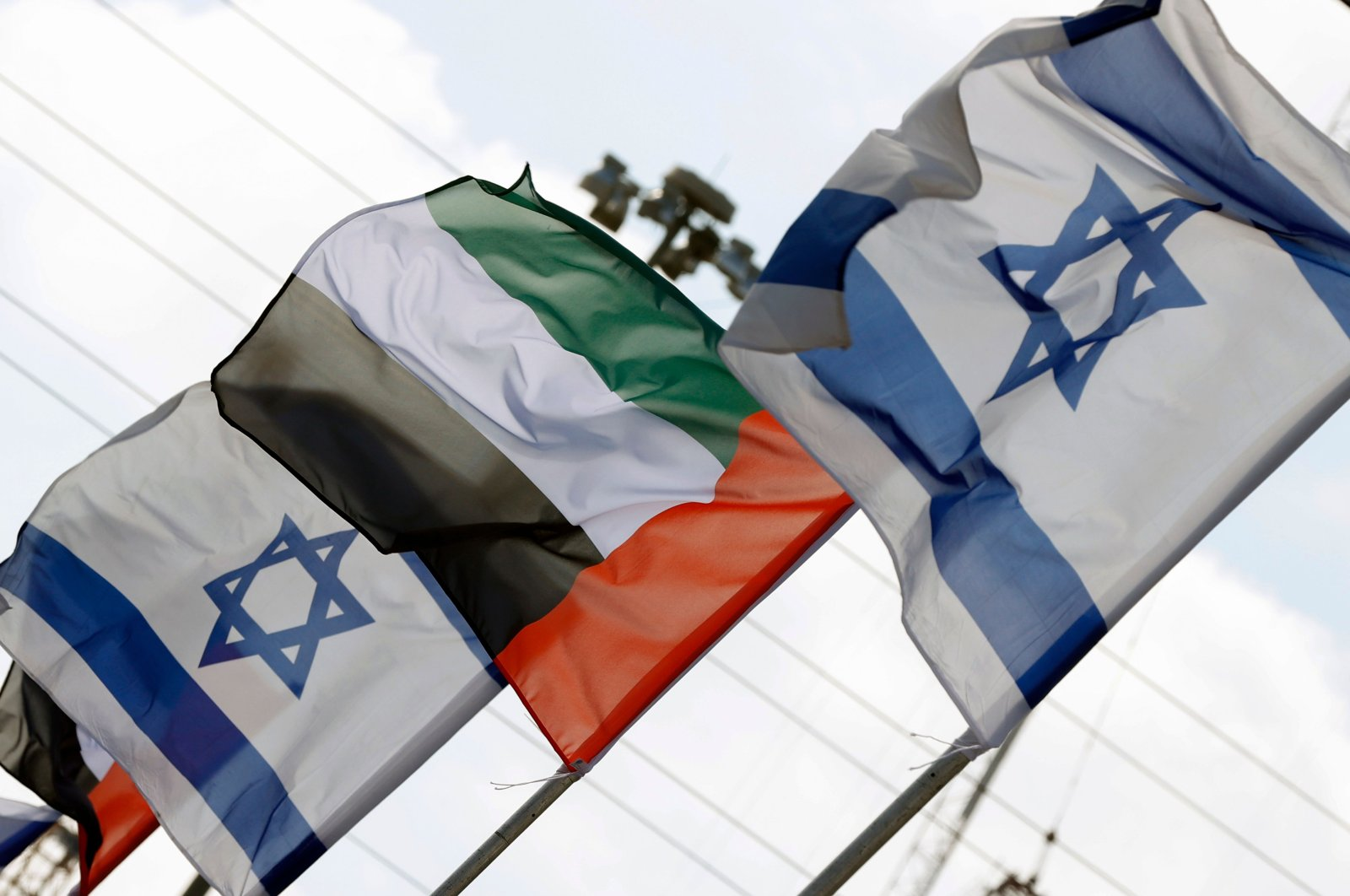In this Aug. 16, 2020, file photo Israeli and United Arab Emirates flags line a road in Netanya, Israel. (AFP Photo)