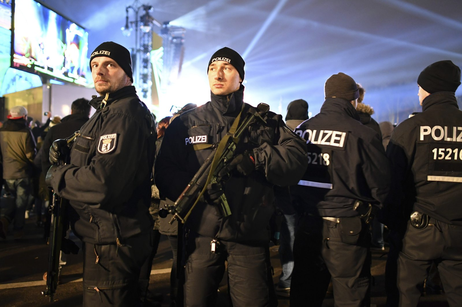 Police officers with submachine guns secure the New Year's Eve party at the Brandenburg Gate in Berlin, Saturday, Dec. 31, 2016. (AP Photo)