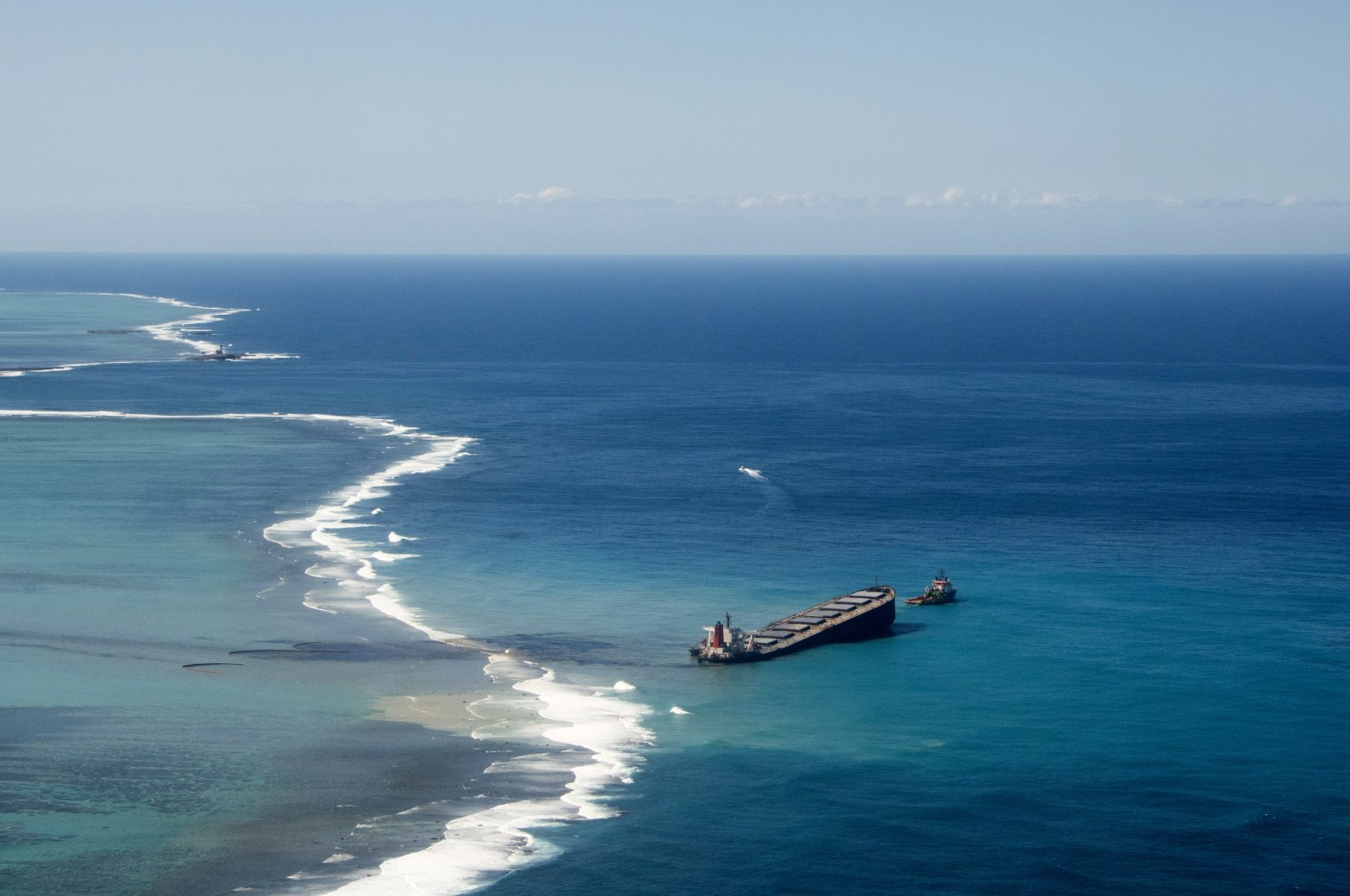 This photo provided by the French Army shows oil leaking from the MV Wakashio, a bulk carrier ship that ran aground off the southeast coast of Mauritius, Aug.11, 2020. (AP Photo)