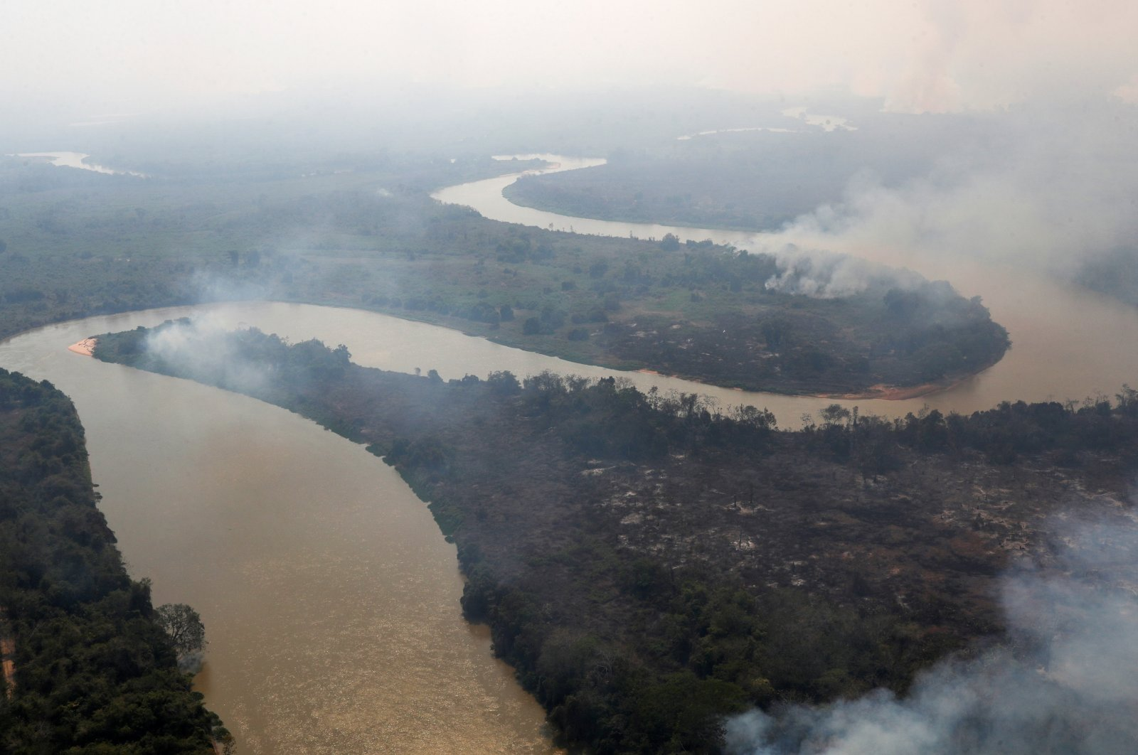 Smoke from a fire is seen near Cuiaba River at Pantanal, in Pocone, Mato Grosso state, Brazil, Aug. 28, 2020. (Reuters Photo)