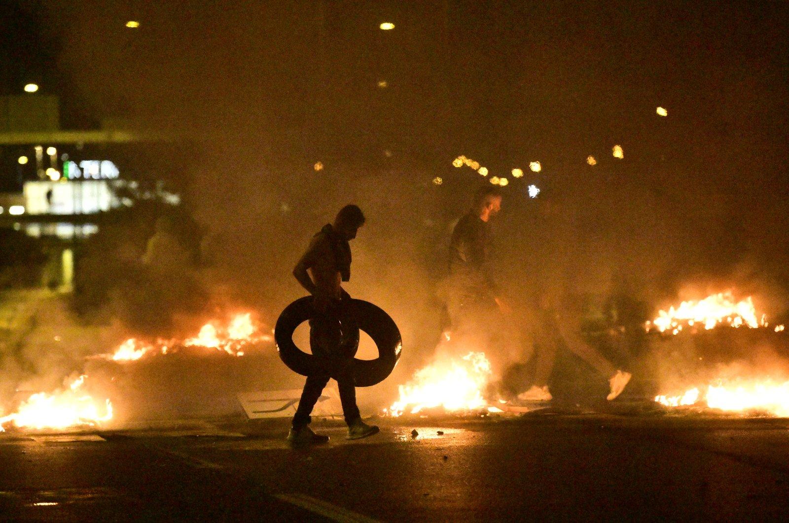 Demonstrators burn tires as protesters riot in the Rosengard neighborhood of Malmo, Sweden, Aug. 28, 2020. (EPA Photo)
