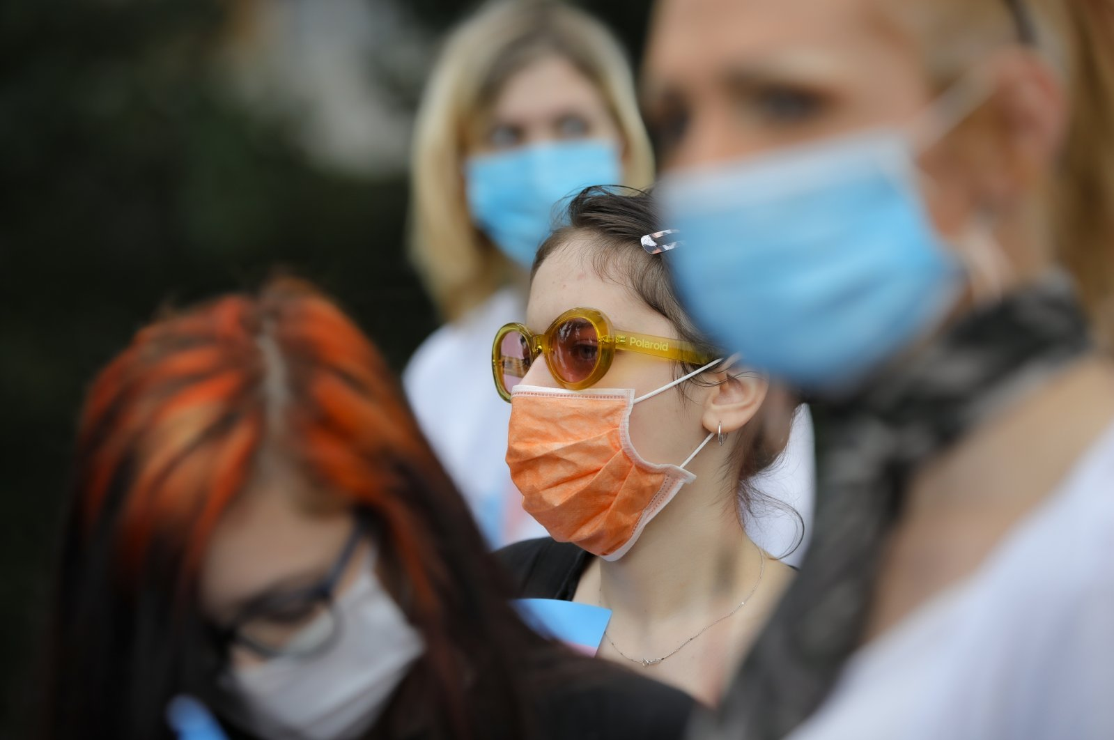 Protesters wear face masks outside the presidential palace in Bucharest, Romania, June 18, 2020, during a rally against a law banning the teaching of gender studies. (AP Photo)