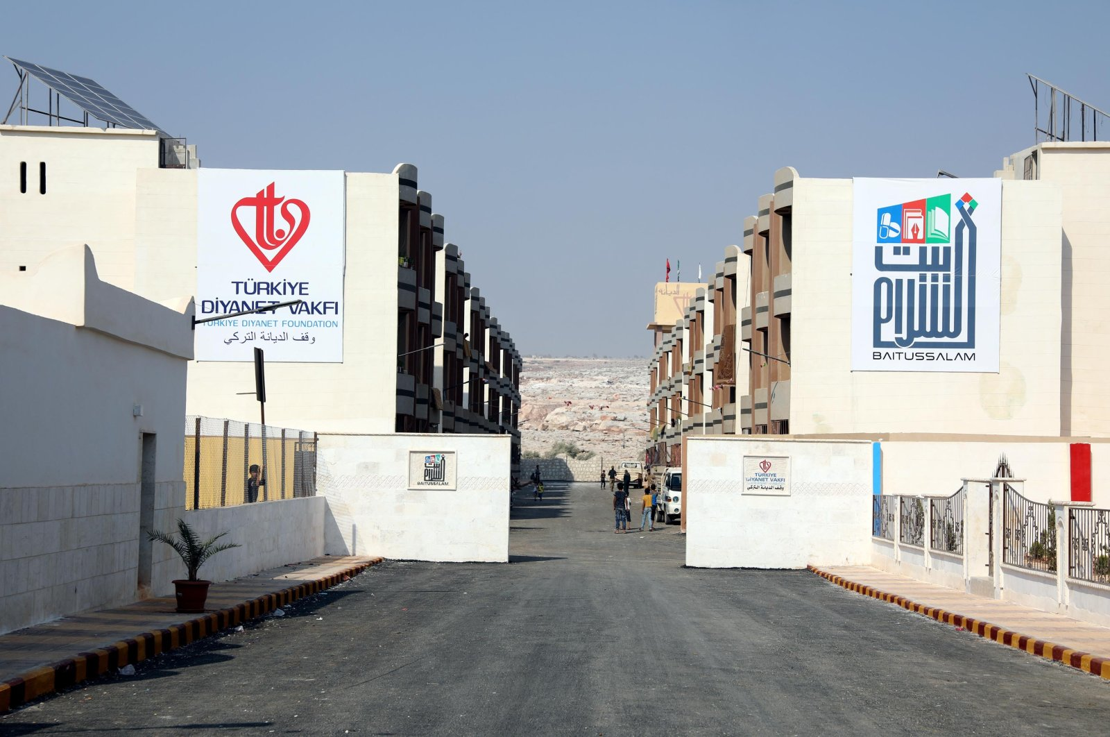The new residential complex constructed by the Turkish Diyanet Foundation and Pakistani Baitussalam Welfare Trust is seen in Idlib, northwestern Syria, Aug. 30, 2020. (DHA Photo)