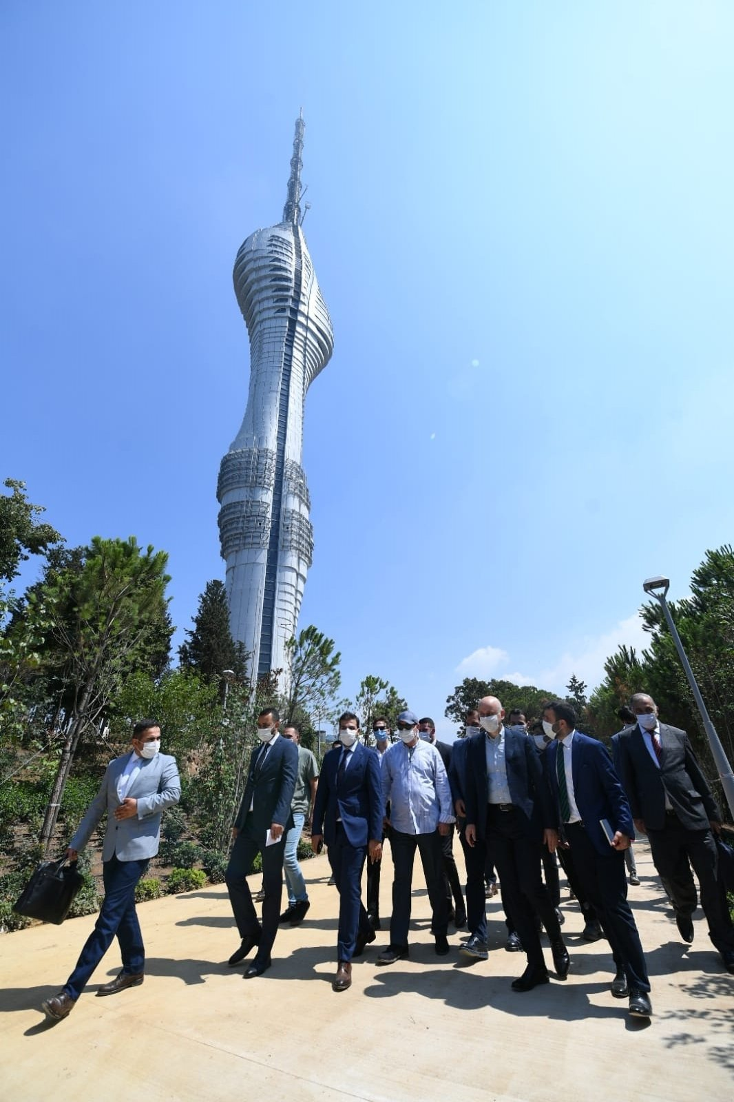 Transport and Infrastructure Minister Adil Karaismailoğlu and other officials walk outside the Çamlıca Tower in Istanbul's Üsküdar district, Turkey, Aug. 23, 2020 (DHA Photo)