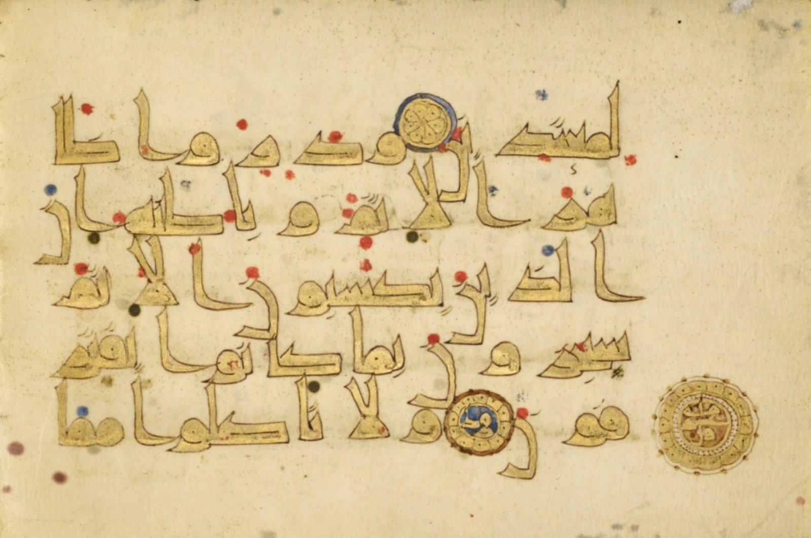 """""""Fragmentary Qur'an,"""" ninth century, pen and ink, gold paint, and tempera colors, 14.4 by 20.8 centimeters. (Courtesy of Getty Museum)"""